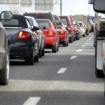 Cars line up against a detour caused by a fatal accident on the highway during rush hour.